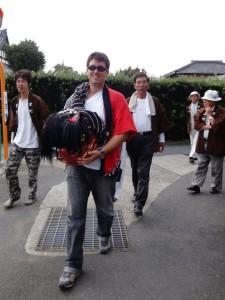 Helping out my neighborhood and going door to door to perform the shishimai (lion dance) during matsuri season.